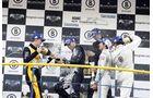 Champagnerdusche bei der Siegerehrung des ADAC GT-Masters