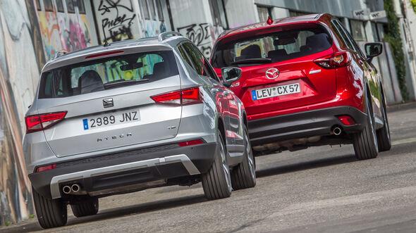 Mazda CX-5 2.0 G 165, Seat Ateca 1.4 TSI, Heckansicht