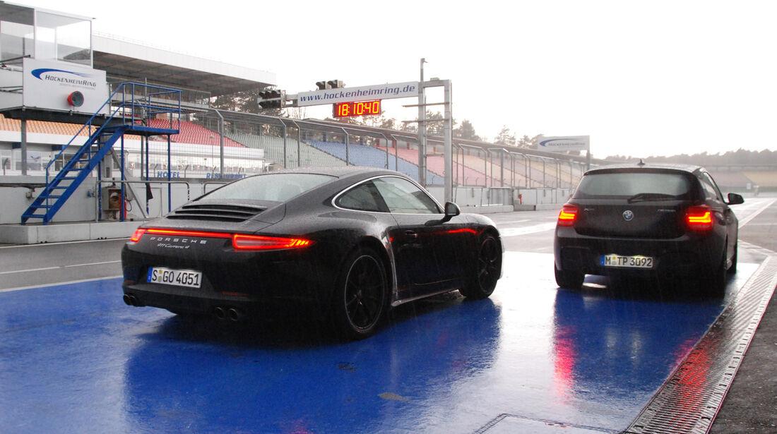 Porsche 911 Carrera 4, BMW M135i xDrive,