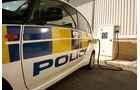Skurrile Polizeiautos, Streifenwagen, Mitsubishi i-MiEv, Laden, Steckdose